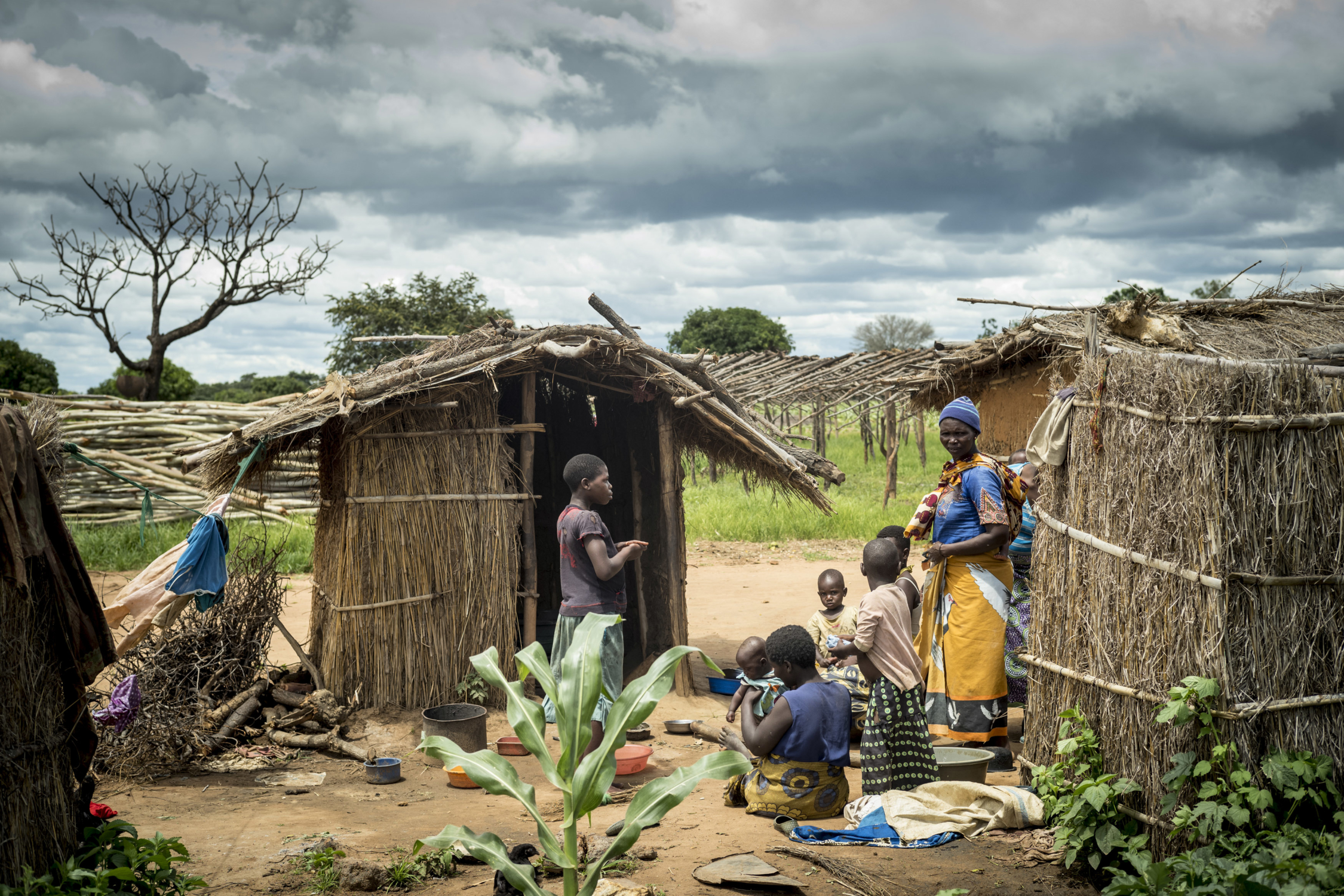 Residents of the tobacco farm village in the Kasungu district of Malawi. Photograph by David Levene.
