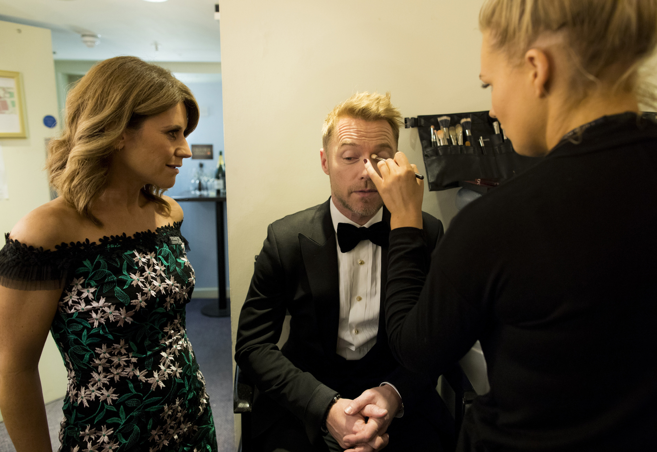 Presenters Harriet Scott and Ronan Keating have their make-up adjusted before taking to the stage. Photograph by David Levene, 2018.